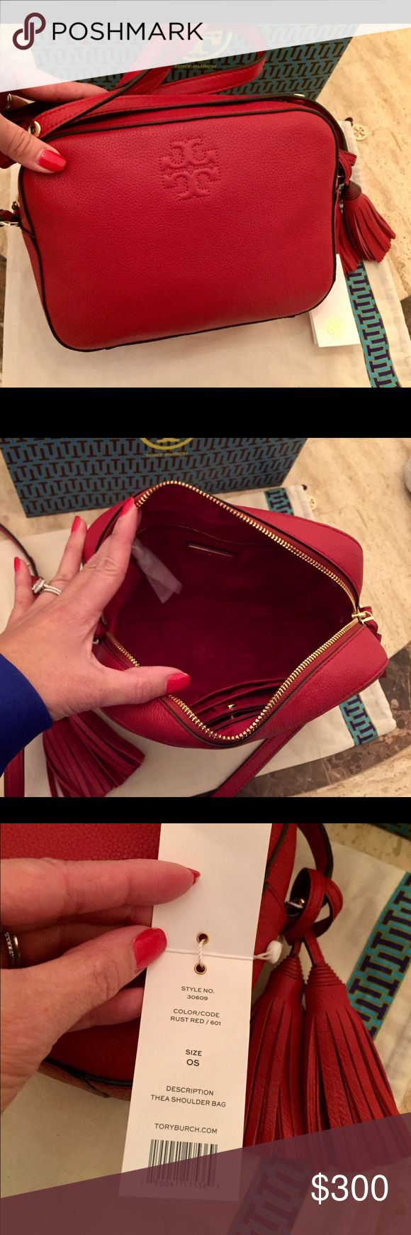 """New! Tory Burch Thea Shoulder Bag Brand new w/ tags! Rust red color. Last photo in black for sizing reference only. Comes w/shopping & dust bag.  Holds mini wallet, camera, notebook, an agenda, sunglasses, iPhone 6 Plus & fragrance rollerball Pebbled leather Top zipper closure Adjustable cross-body strap w/ 23.31"""" (58.5 cm) drop 1 interior zipper pocket, 2 open pockets Height: 6.97""""  Length: 9.36""""  Depth: 2.79""""   *This is the Shoulder Bag NOT the mini, lots of room. Online-Neiman sells it…"""