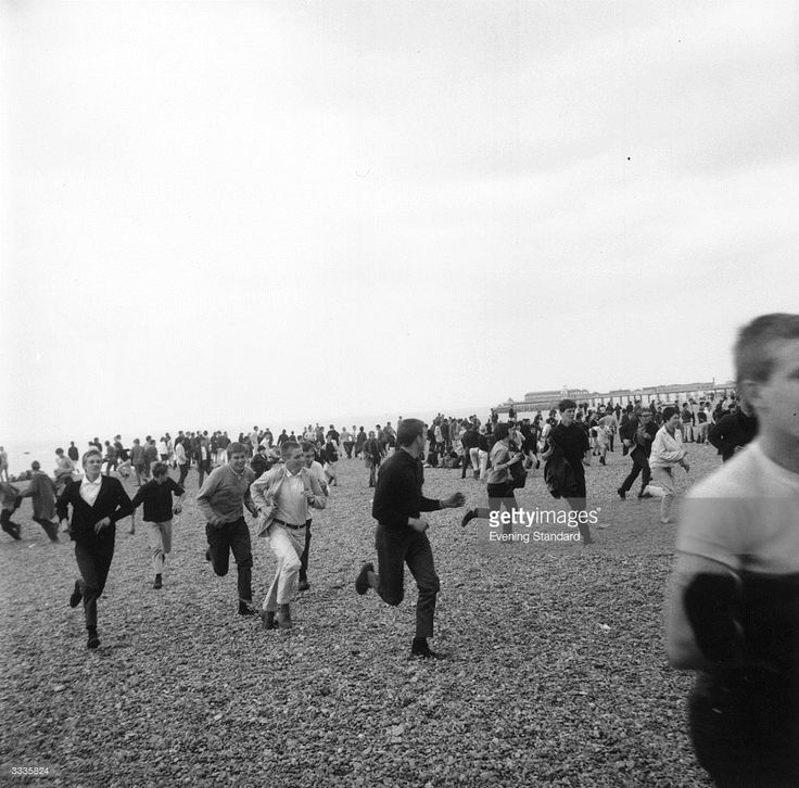 A group of Mods running along the beach at Hastings, Kent, during violence…