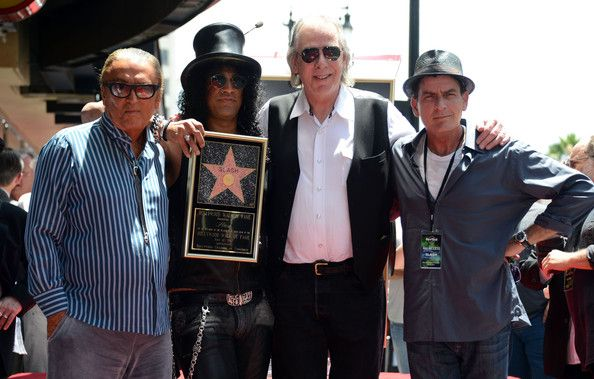 """Charlie Sheen Photos Photos - Former """"Guns & Roses"""" guitar god Slash recieves a star on the Hollywood Walk of Fame where the musician was honored by close personal friend Charlie Sheen. While drama has always surrounded Slash's relationship with former bandmate Axl Rose, Sheen was not one to shy away from the topic, joking """"ItÕs quite fitting that Slash is getting a star on the very street Axl Rose will one day be sleeping on. - Slash Gets a Star on the Walk of Fam..."""