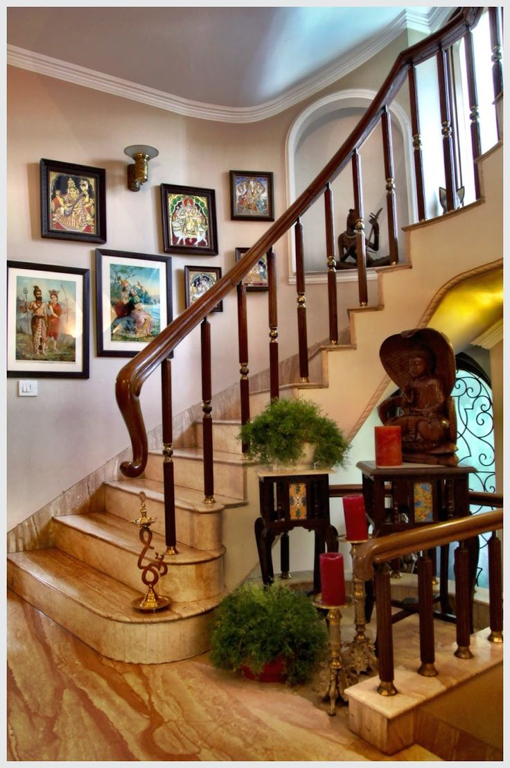 Lining the walls of the stairway are Ravi Varma Lithographs and Tanjore paintings that create a gallery wall effect