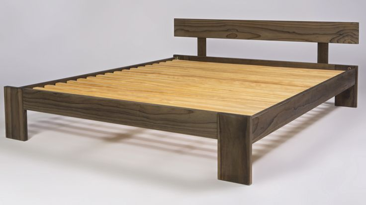 Solid wooden base, with an inky finish: http://www.futonz.co.nz/slat-bed-bases-classic.html