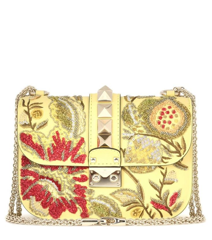 Valentino - Valentino Garavani Lock Small embroidered shoulder bag - Valentino Garavani's sweet-toned creations have us yearning for simpler times. The classic and compact Lock Small design with signature stud detailing has been updated in a pastel yellow hue with an allover embroidered and beaded floral design. Wear yours slung over the shoulder next to soft, printed dresses for feminine vibes. seen @ www.mytheresa.com #valentinopurse