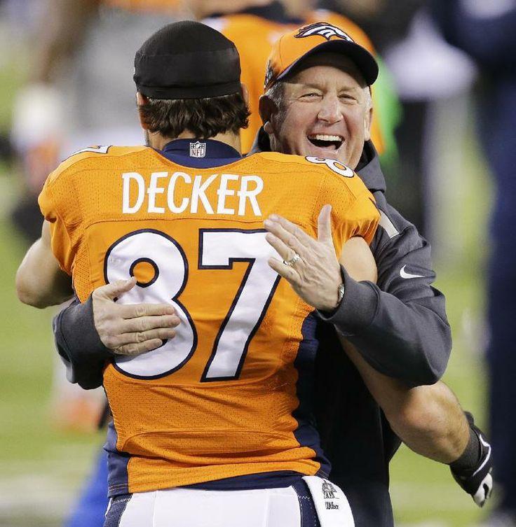 Denver Broncos head coach John Fox laughs as he talks to Eric Decker before the NFL Super Bowl XLVIII football game against the Seattle Seah...