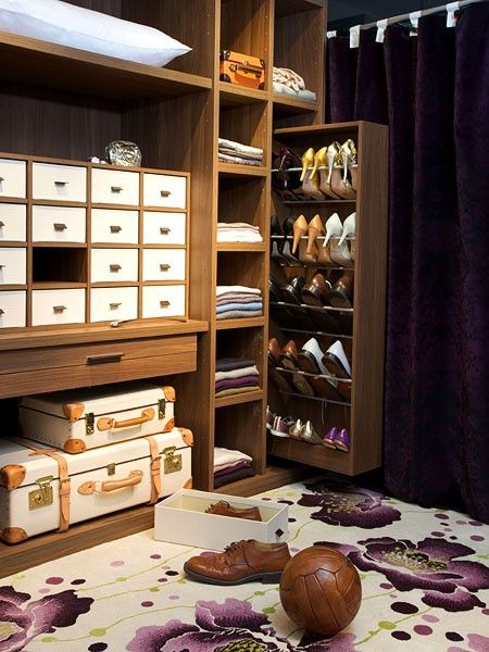 walk in closet with buil tin cabinets featuring accessory cabinet sweater shelves and pullout shoe cabinet