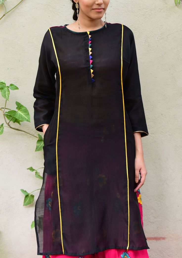 Handwoven chanderi kurta tunic and dresses This black round neck kurta is made out of chanderi to make you feel comfortable throughout the day.*100% Cotton *placket with hidden button fastening in front *kurta has long sleeve *straight kurta *Round neck *piping and triangle detailed
