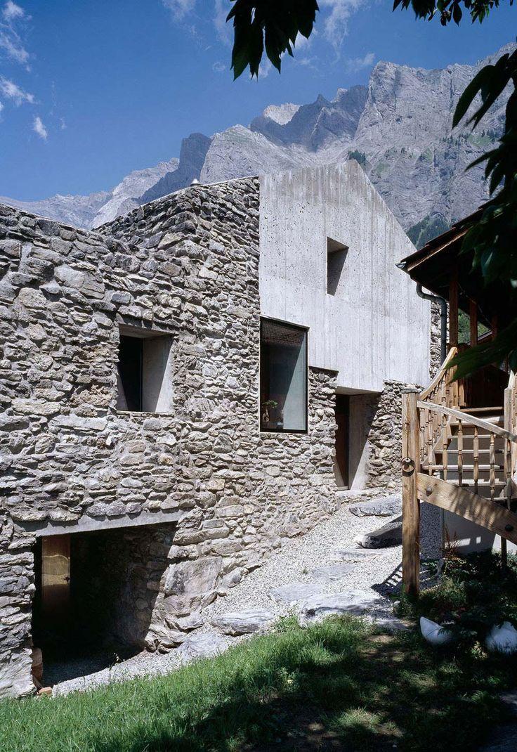 Concrete, Stone Walls, Renovation in Chamoson, Switzerland by Savioz Fabrizzi Architecte, stone, entrance, windows