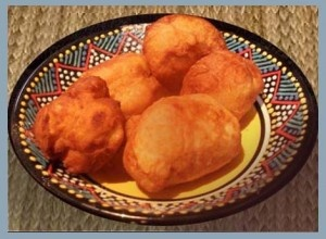 South African Vetkoek 'Fet Cook', they are delicious alternative to bread and can be eaten as a savoury dish, served with a beef mince sauce, or sweet with golden syrup or apricot jam and a with a cup of strong black coffee.