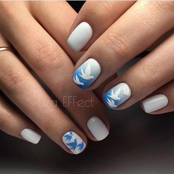 For those, who prefer the unshowy but original manicure, suit such variant. White and dark sky blue nail polishes are ...