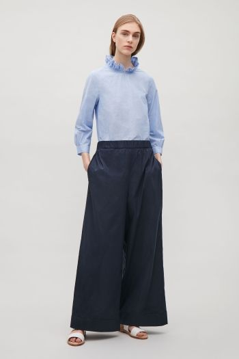 COS image 1 of Frill-neck blouse in Sky Blue