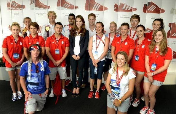 Kate wears a Smythe navy blazer, Adidas Team GB white polo, J Brand 811 mid rise and Stuart Weitzman Corkswoon shoes while Kate Middleton and Prince Harry meet Team GB's gold medal winners on 8/9/12.