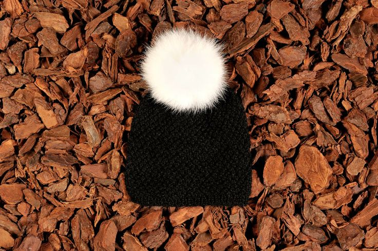 Knitted beanie in black alpaca wool with a fur tassel. Natural materials and handmade in Denmark.