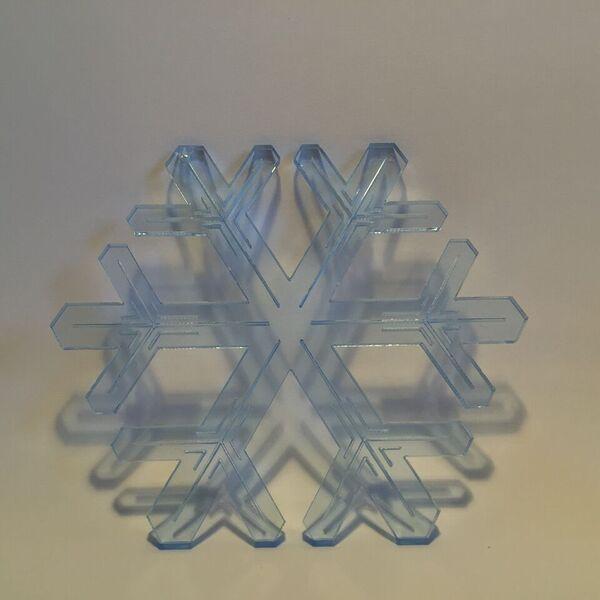 Ice blue plexiglass lasercut. by Bror David.