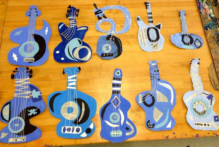 Picasso Blue Period abstract guitars monochromatic tint/shade using tempera paint, paper, newspaper, string.