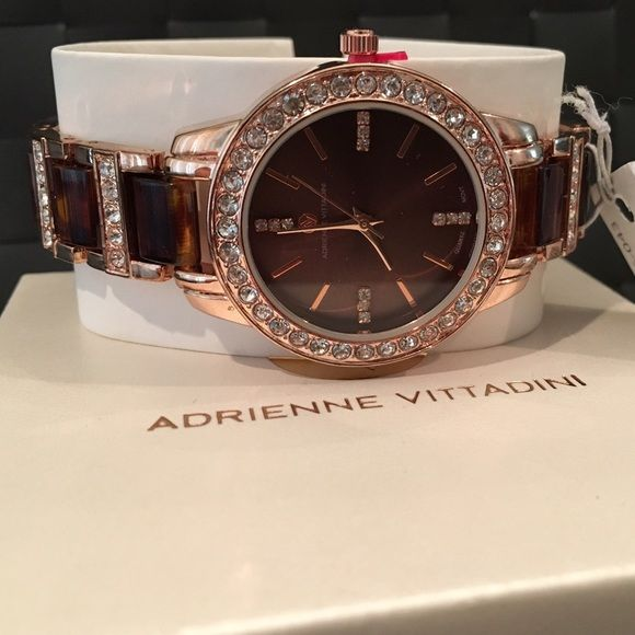 SUPER SALEBeautiful Adrienne Vittadini Watch Beautiful Brown/Gold Womens watch with crystals really shines! Brand new with tags. Still in original box. Offers welcome. Adrienne Vittadini Accessories Watches