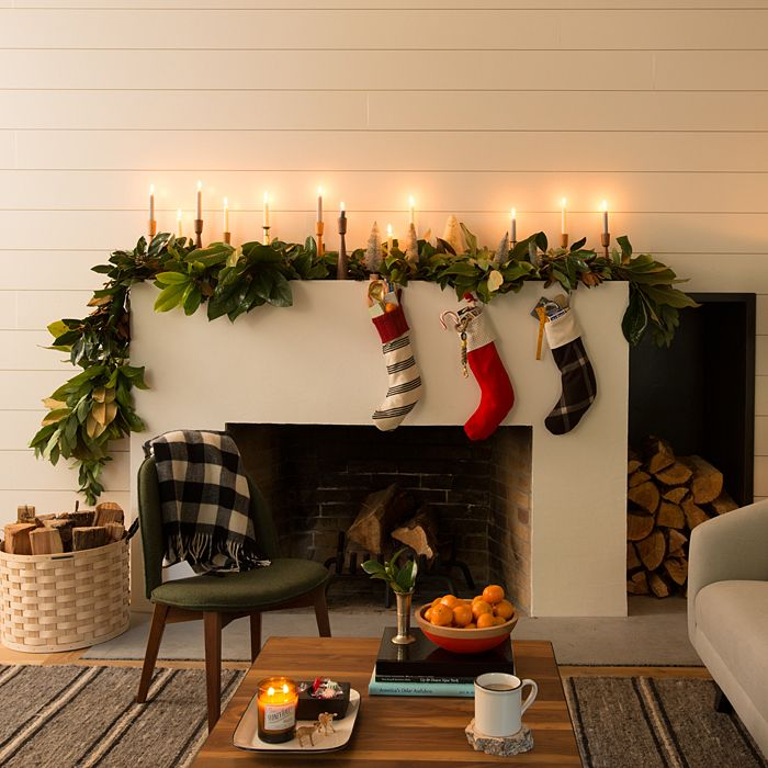 Holiday fireplace with candles simple stockings and big for Christmas mantel decorations garland