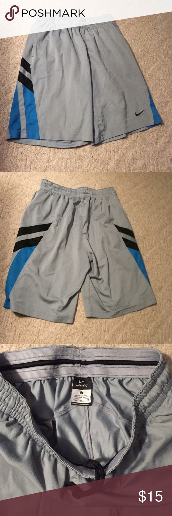 Nike Dri-Fit Shorts Nike men's shorts, used but not for very long, still in pretty good condition. *Colors light gray, blue and black. *Train with comfort on your side with moisture wicking technology. *2 front pockets. *Elastic waistband with internal draw string. *Size medium. Nike Shorts Athletic