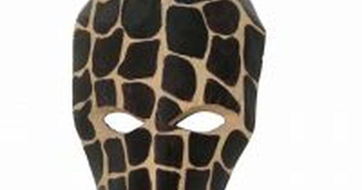 Como fazer máscaras africanas de papel. Máscaras africanas possuem uma aparência interessante e uma relevância histórica única, o que as torna um projeto apropriado para crianças aprenderem sobre a cultura e história africana, ou mesmo para decoradores que buscam criar uma decoração de parede para quartos com temática africana ou eclética. Papel pode ser usado para fazer máscaras ...