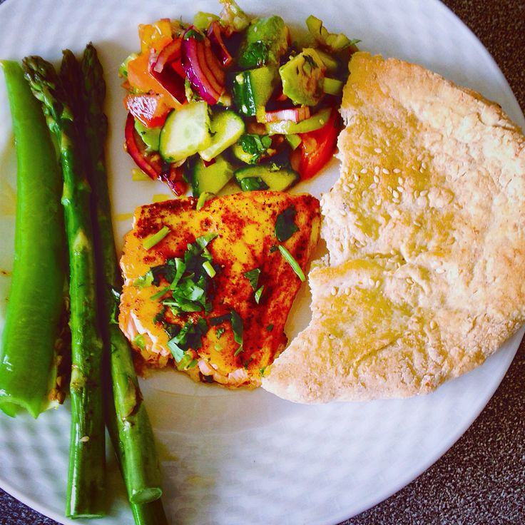 Grilled  marinade salmon with paprika, chili pepper , coriander , lime  Grilled asparagus , green bell pepper , home bake Bread  Salad made of cucumber , tomato, red onion, green pepper, avocado ,red wine vinegar , pomegranate