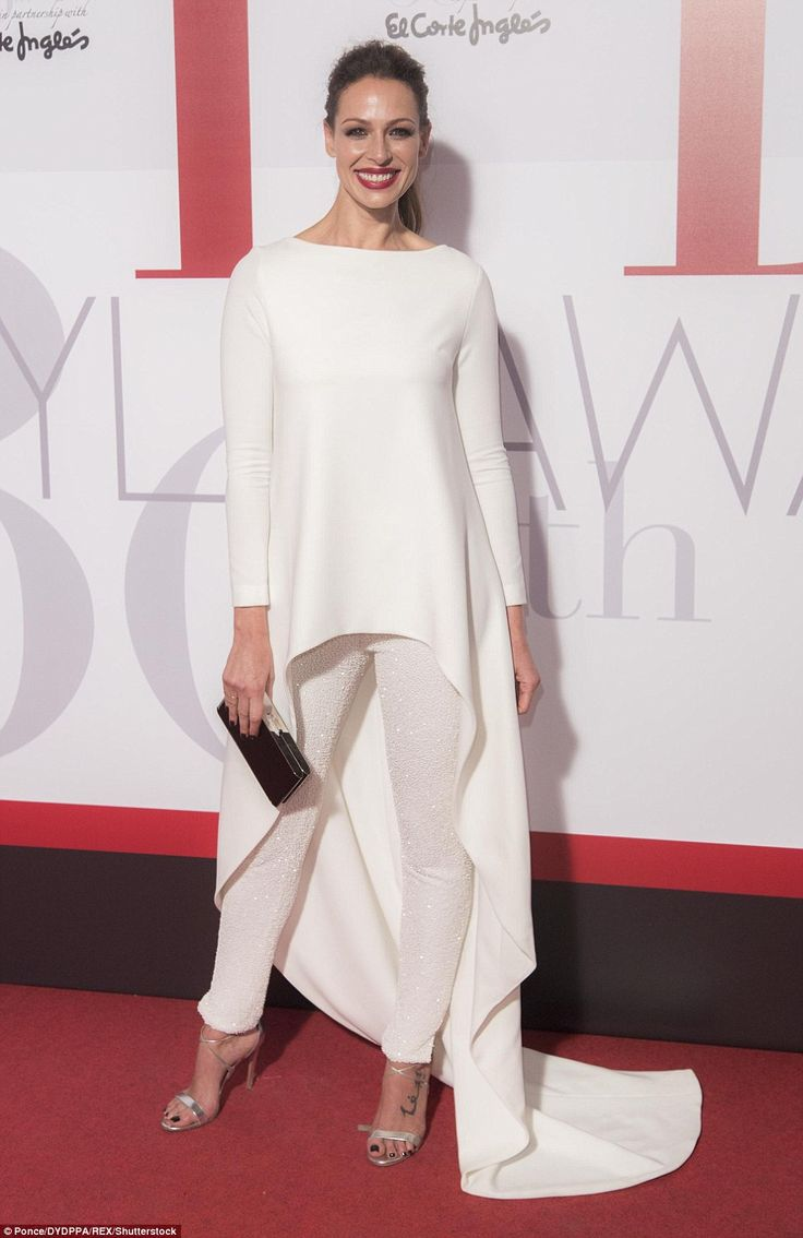 Alright in white: Spanish actress Eva Gonzalez put on a stylish display in sequinned trousers and a flowing, floor-length top