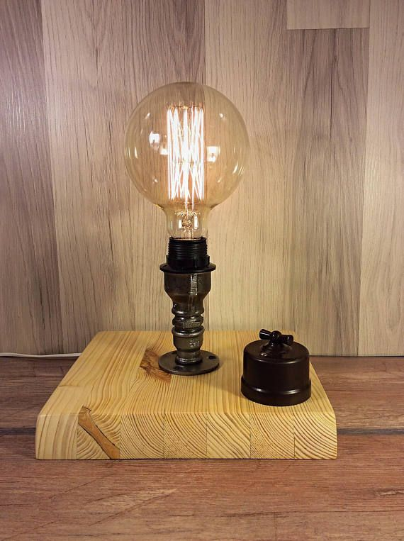 Table Lamp Made Of Cast Iron Fittings On A Wooden Base On Off
