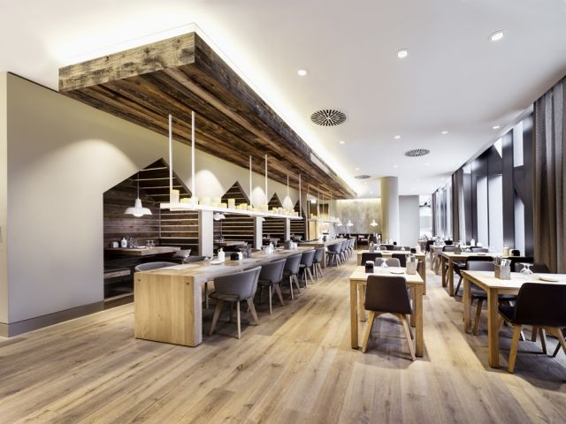 Sansibar, in Dusseldorf by Dittel Architekten and inspired by a taste of sea air. Materials: old wood for the paneling and solid oak for the tables #harmony #wood #fresh