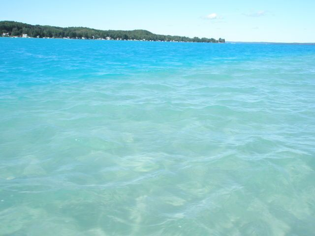 The turquoise waters of Torch Lake. #michigan Photo via https://www.homeaway.com/vacation-rental/p3663360