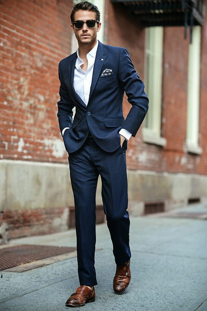 Blues and navy are a hot trend right now for grooms' suits.: