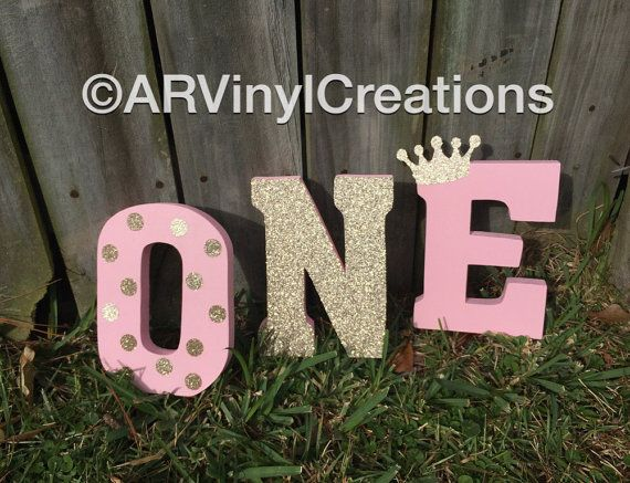 This beautiful photo prop is sure to be the perfect accent to any little one year olds photos. The perfect touch of light pink and gold to add