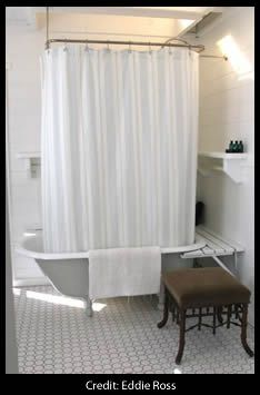 Grey clawfoot tub w curtain