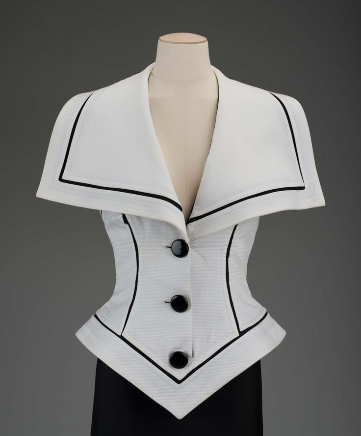 Jacket | Gnyuki Torimaru, Japanese, worked in England, born in 1937 | England, 1992 | White cotton pique halter vest with black accents. Three black buttons down front and oversized collar | Museum of Fine Arts, Boston