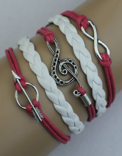 "Our popular leather wrap bracelets - this one features the infinity symbol, a music note, and an arrow.  Dark pink and white with silver.  6 inches with a 2 inch extender and lobster clasp closure.  If this ModWrap notes ""Available on backorder"", you will receive it in 1-2 weeks."