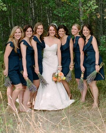 Lyn in a Tara Keely by Lazaro gown; her bridesmaids wear BCBG dresses and carry bouquets of fresh lavender.