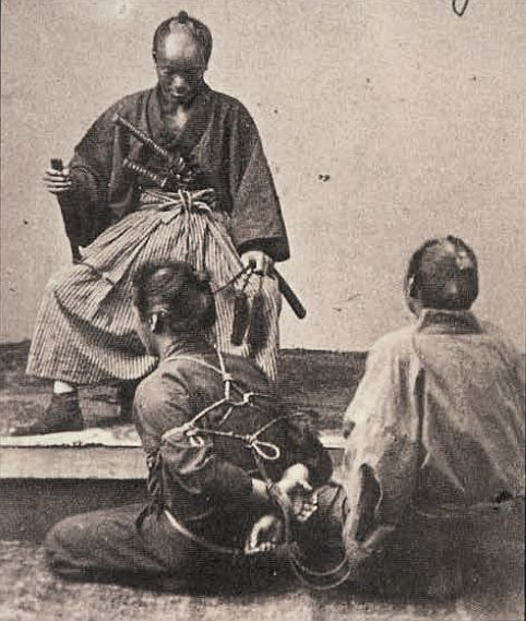 Bound prisoner facing samurai justice.