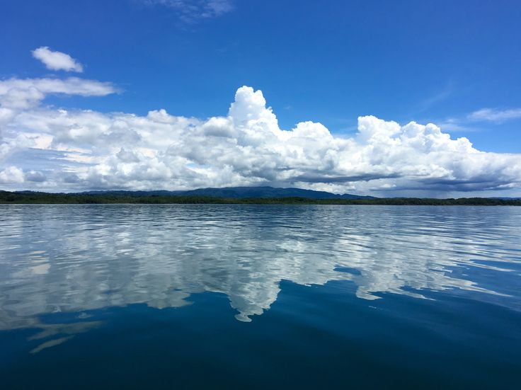 Perfect mirror image of the sky on the calm waters of Golfo Dulce, Costa Rica. Be part of the dream at Golfo Dulce Retreat www.gdretreat.com
