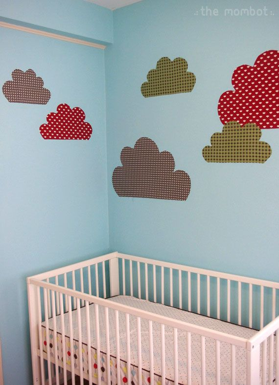 Hang fabric decals using starch. Just like a sticker, only fabric!