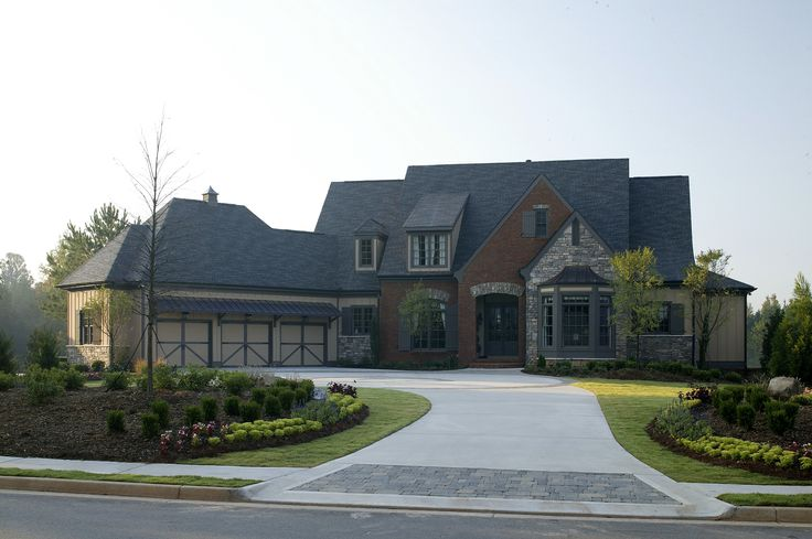 This Traditional Style Home Has A Long Paved Driveway