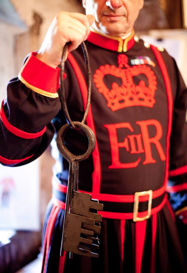 TOWER OF LONDON BEEFEATER - HOLDING KEY'S (CENTURIES OLD) THAT LOCK UP CERTAIN DOORS WITHIN THE TOWER. SO SPECIAL - THAT THE BEEFEATER RESPONSIBLE IS OF A HIGHER POSITION.