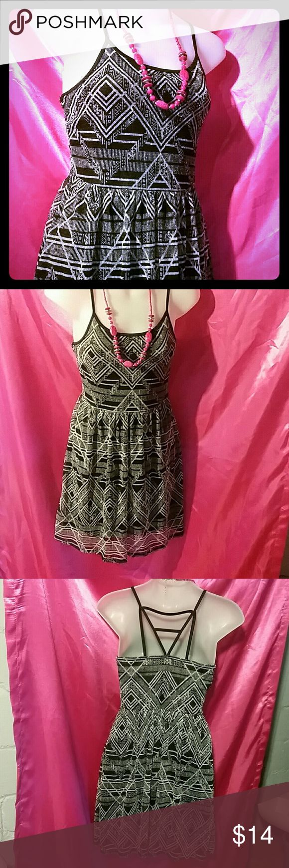Black/white Aztec party dress Another dress great for a party or also can be worn as a sundress has black slip under see-through top with spaghetti straps and design on the back great dress for many occasions with empire waist  no boundaries  Dresses