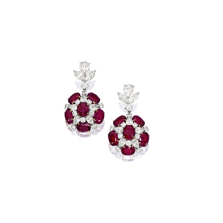 PAIR OF RUBY AND DIAMOND EARRINGS Each set with si…