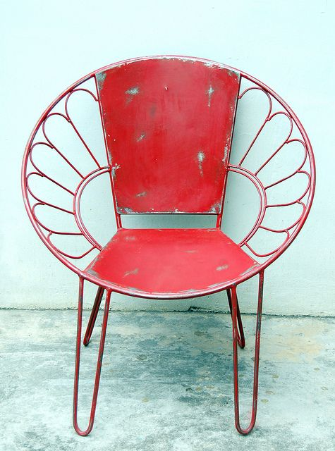 Metal weathered red chair.
