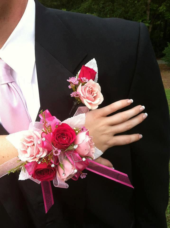 Pink corsage and Pink Boutonniere http://jldesignsfloral.com/wp-content/uploads/2012/09/Pink-Mini-Roses-Corsage-and-Bout.jpg