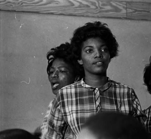 Lula Williams and two other young women in the audience at Harrison Street Baptist Church in Greenville, Alabama, probably listening to Martin Luther King, Jr., speak. :: Jim Peppler Southern Courier Photograph Collection