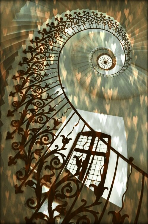 Beautiful staircase with heart-shaped light pattern..