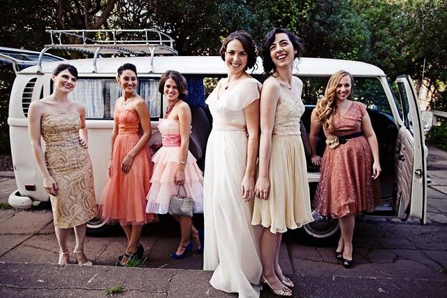 mismatched vintage bridesmaids dresses in autumn colors