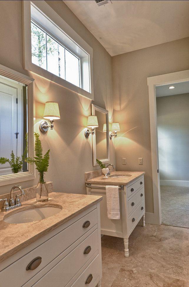 bathroom beige, Benjamin Moore White Sand, sconces, dressers recycled as sinks,