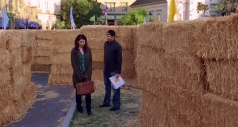 """Luke and Lorelai in the hay bale maze (episode 18, """"Hay Bale Maze"""") via GIPHY"""