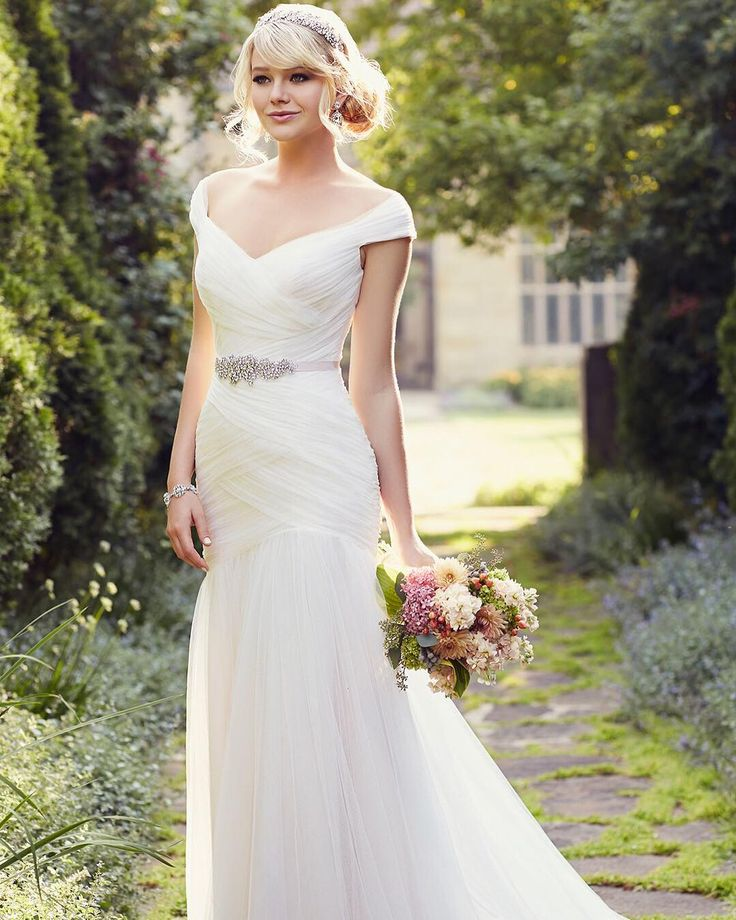 This sophisticated wedding gown from @essenseofaustralia is perfect for a whimsical bride!   #whimsicalweddingdress  #sophisticatedwedding #tulle #capsleeves #ruching  #lace  #weddingdressshopping #weddinggown #weddingdress #ftbboutique #bridalfashion #bridalstyle #engaged #ftmyersbridalshop #ftmyersbridalboutique #ftmyerswedding #AllureBridals #EssenceOfAustralia #MaggieSottero #CallaBlanche #farage #VenusBridal #ftmyers #naples