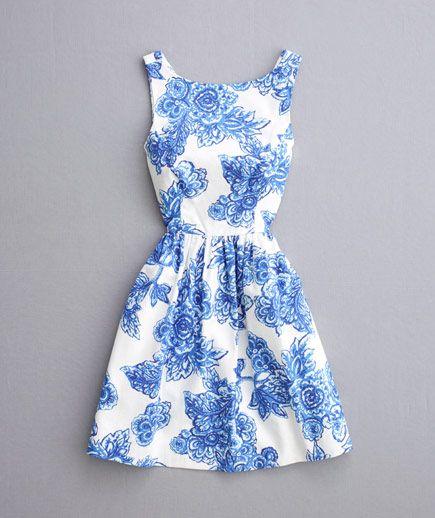 9529e93c4e6 ... blue floral patterned dress with bateau neckline ...