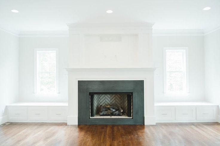Fireplace+design+with+black+honed+granite+and+herringbone+firebox+||+Studio+McGee.jpg