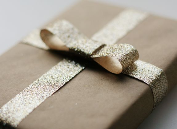 DIY gift wrapping idea with glitter bow.